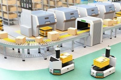 Self driving AGV with forklift carrying container box beside conveyor